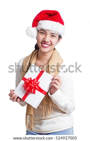 Happy asian lady holding a christmas gift. Isolated in white background.