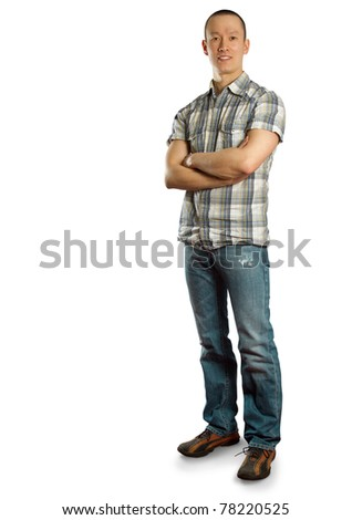 happy asian male in jeans  against different backgrounds - stock photo
