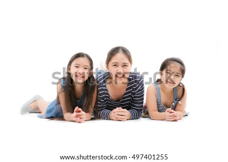 Happy Asian mother and daughter lying on isolated white background, Happy family