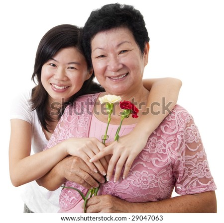 Happy Asian Mother and Daughter with carnation flower - stock photo