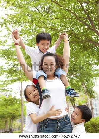 Happy Asian Mother with her daughter and son - stock photo