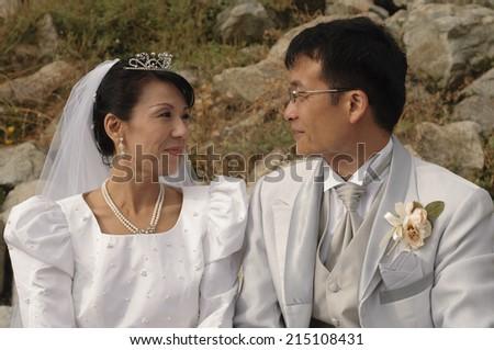 Happy Asian Newlyweds  - stock photo