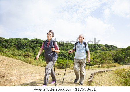 happy asian senior couple hiking - stock photo