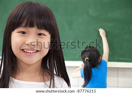 happy asian student girls at school classroom - stock photo