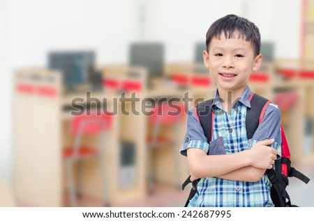 Happy Asian student in computer room at school  - stock photo