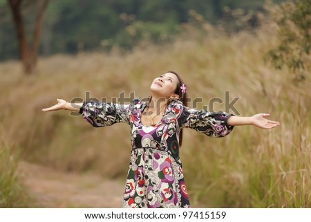 happy asian woman breathing in nature, thailand - stock photo
