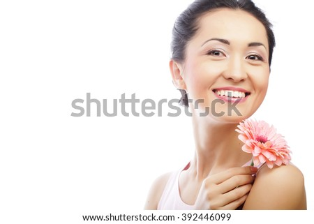 happy asian woman holding a pink gerbera - stock photo