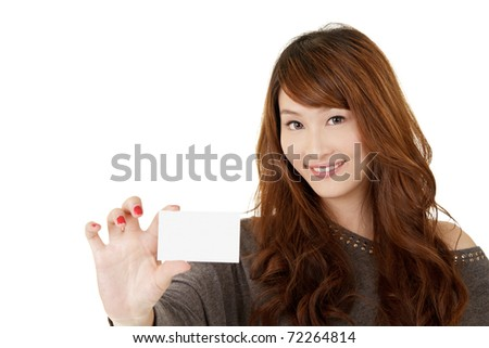 Happy Asian woman holding blank card and smiling, closeup portrait on white background. - stock photo