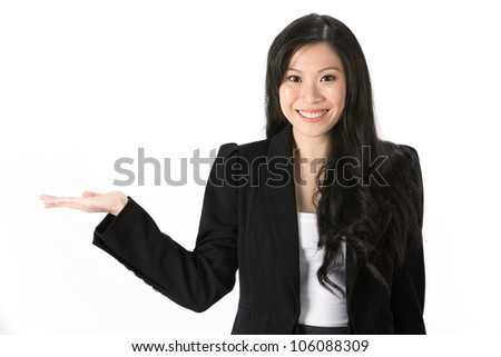 Happy Asian woman holding out her hand to show your message. Isolated on white background. - stock photo