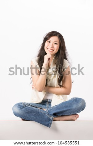 Happy Asian woman in casual clothes. Isolated on white background. - stock photo