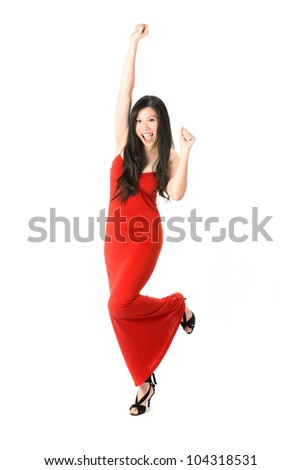 Happy Asian woman in red dress celebrating. Isolated on white. - stock photo