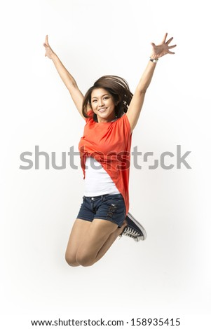 Happy Asian woman jumping for joy. Isolated on a white background. - stock photo