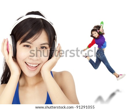 happy asian woman listen music and dancing - stock photo