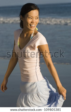 Happy  asian woman on the beach - stock photo