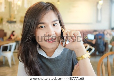 Happy asian woman talking on cellphone in hipster cafe, Women rest in cafe