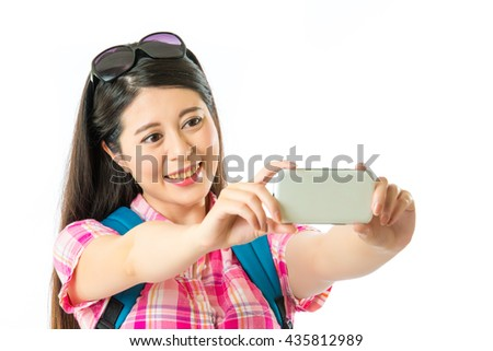 Happy asian woman tourist taking selfie on white background