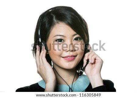 Happy Asian woman wearing a call center headset. Isolated on white background. - stock photo