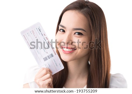 Happy Asian woman with a boarding pass - stock photo