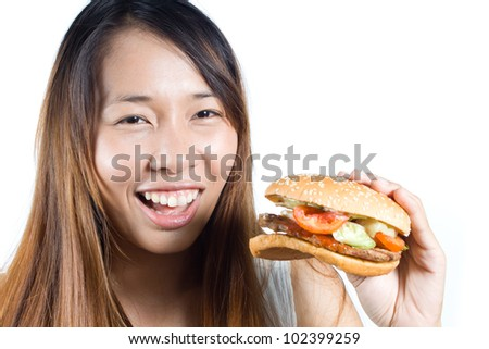 Happy asian woman  with  her hamburger on  white background