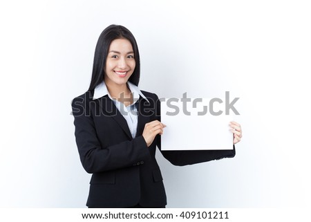 Happy asian young business woman showing blank whiteboard, isolated over white background.