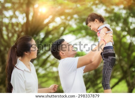 happy asian young family spending time outdoor on a summer day - stock photo