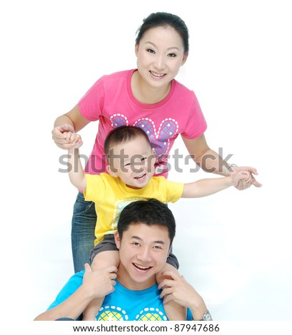 Happy Asian young family with cute child - stock photo