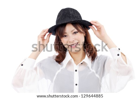 Happy asian young girl wearing hat, smiling, looking at camera, on white background - stock photo