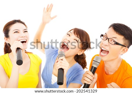 happy asian young group having fun singing with microphone - stock photo