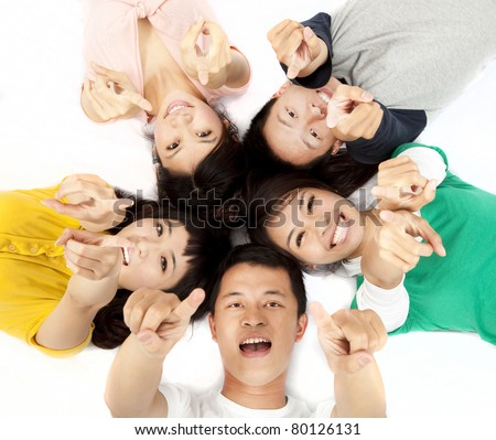 happy asian young group pointing at you - stock photo