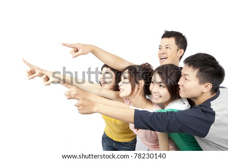 happy Asian young group pointing away isolated on white background - stock photo