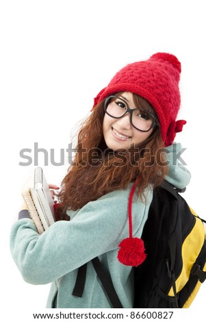 Happy  Asian young woman in winter hat and wear - stock photo
