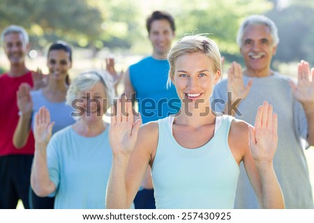 Happy athletic group showing their hands on a sunny day - stock photo