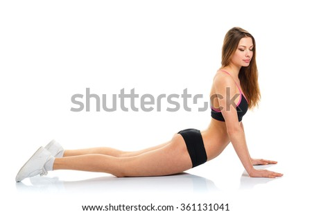 Happy athletic woman doing sport exercise, isolated on white background