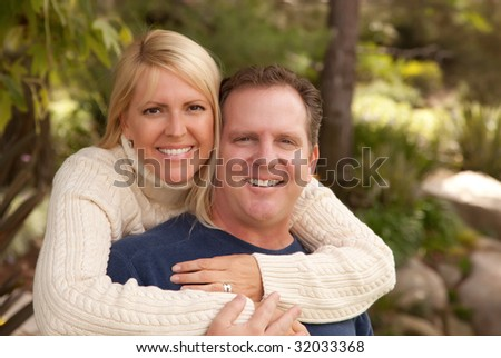 Happy Attractive Adult Couple Portrait in the Park. - stock photo