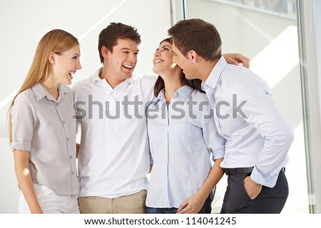 Happy attractive business group standing in an office - stock photo