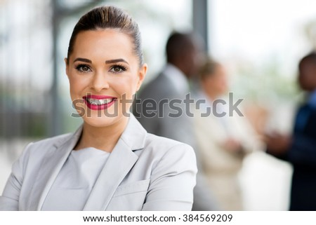 happy attractive businesswoman in office - stock photo