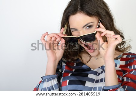 Happy attractive excited teen girl makes faces - stock photo