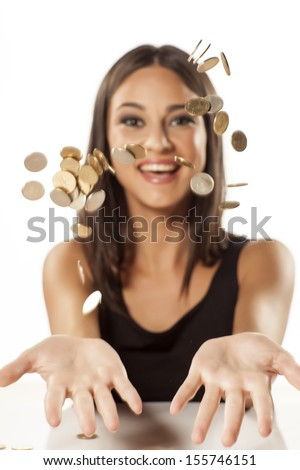 happy attractive girl throws the coins up in the air - stock photo