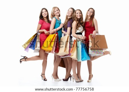 Happy attractive girl with shopping on white background - stock photo