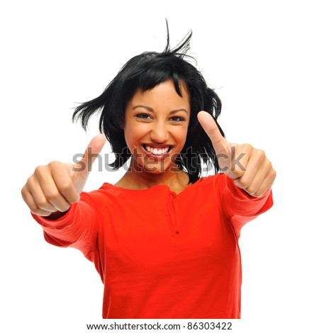 Happy attractive girl with two thumbs up and windswept hair, shot in studio isolated on white - stock photo