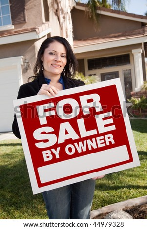 Happy Attractive Hispanic Woman Holding For Sale By Owner Real Estate Sign In Front of House. - stock photo