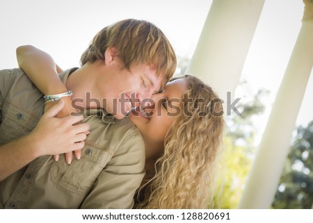 Happy Attractive Loving Couple Portrait in the Park. - stock photo