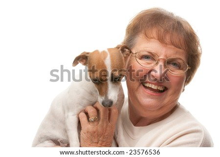 Happy Attractive Senior Woman with Puppy Isolated on a White Background. - stock photo