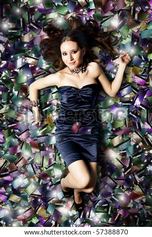 happy attractive woman swiming in a pool of credit cards