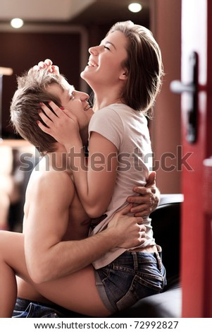 happy attractive young adults hugs each other - stock photo