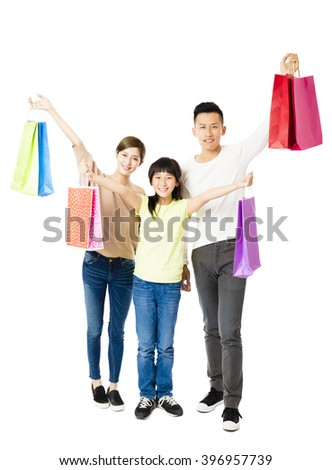 Happy Attractive Young  Family with shopping bags - stock photo