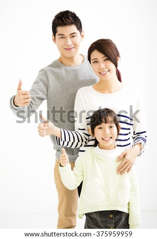 Happy Attractive Young  Family with thumb up - stock photo
