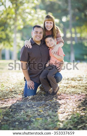 Happy Attractive Young Mixed Race Family Portrait Outdoors. - stock photo