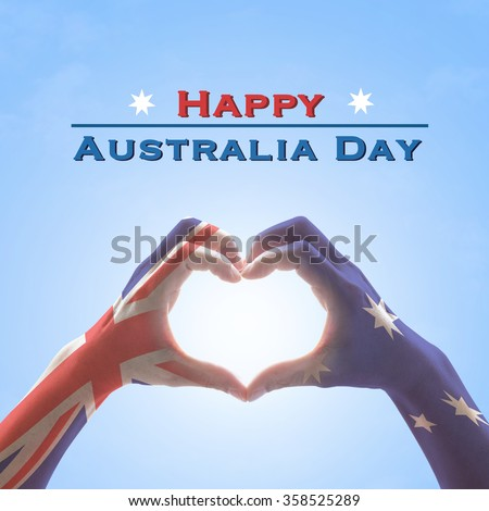 Happy Australia Day: Australian flag pattern on people hands in heart love shaped form on isolated on blue sky background: National public holiday celebration symbolic concept design idea  - stock photo