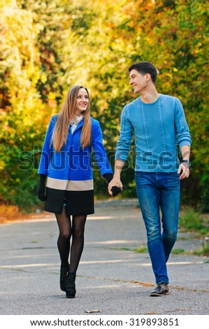 happy autumn couple in love portrait. outdoor. full length - stock photo
